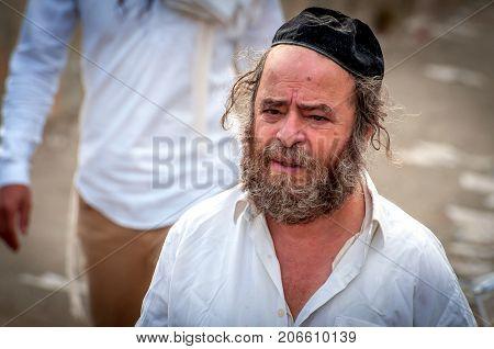 Aged, Beggar Hasid Pilgrim On The City Street. Uman, Ukraine - 21 September 2017: Holiday Rosh Hasha