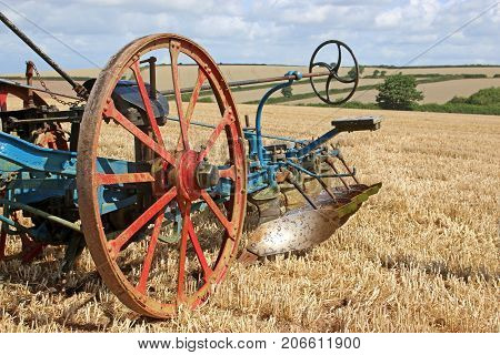 Vintage plough in a field after harvest