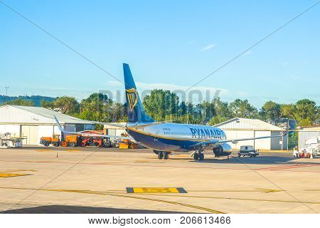 Bologna, Italy - June 30, 2017: Ryanair low cost aircraft parked at Bologna airport BLQ, with blue sky and copy space. Ryanair is main european low cost flights company.