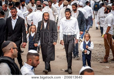 The fathers leads the sons by the hand. The Hasidim pilgrims. Uman Ukraine - 21 September 2017: Rosh Hashanah Jewish New Year.