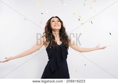 Beautiful Asian Woman With Confetti Falling Everywhere On Her. Birthday Or New Year Eve Celebrating