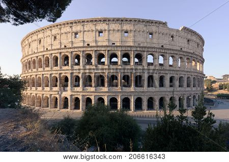 The ancient Roman amphitheater appears complete in the sunrise with no visible people from the terrace of Monte Oppio a touristic popular spot.