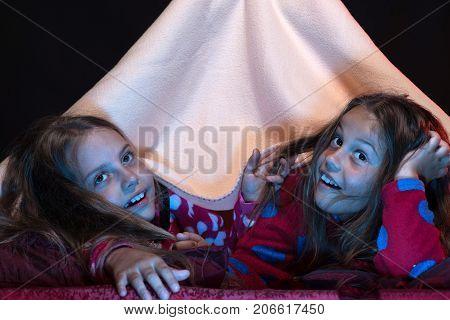 Pyjamas Party For Children. Girl Friends Under Blanket
