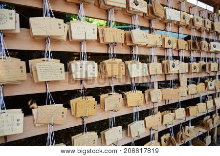 TOKYO, JAPAN - MAY 15: Many wooden of Votive Tablets at Meiji Shrine in Tokyo, Japan