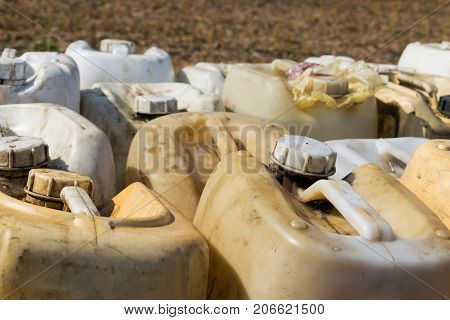 Canisters with fuel or other chemicals on the field