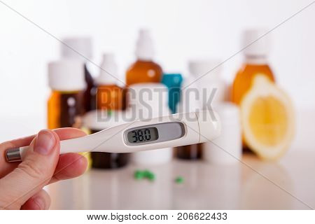 Drug prescription for treatment medication. Pharmaceutical medicament cure in container for health.thermometer with a temperature of 38