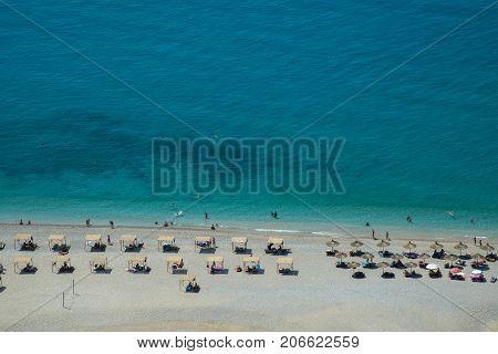 Famous organized Gjipes beach in Albania. Over view. Blue Mediterranen sea is wonderful.