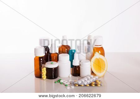 Plastic bottles with medicine isolated on white