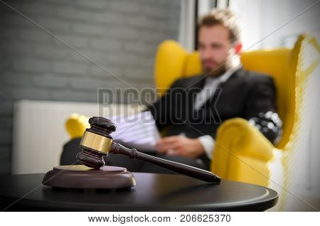Wooden Gavel, Working Lawyer In Background