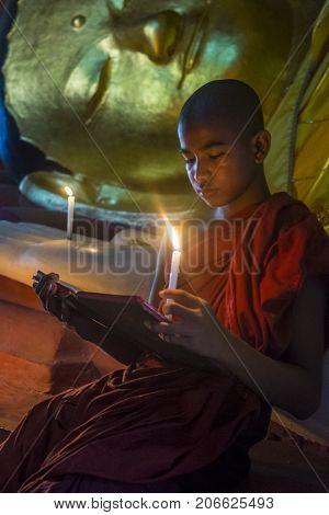 BAGAN MYANMAR - SEP 05 2017: Novice monk in bagan Myanmar on September 05 2017 The ruins of Bagan has 2200 temples and pagodas
