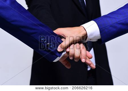 Businessmens Hands Wearing Formal Wear On Grey Background.