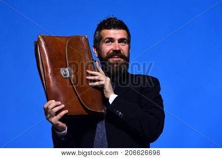Man Holds Brown Case Near His Face. Company Worker