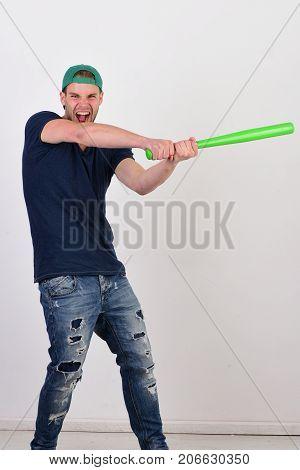 Guy In Dark Blue Tshirt Holds Bright Green Bat