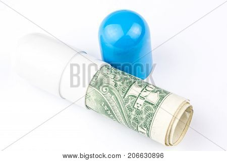 One Dollar Banknote Is Rolled Into A Big Blue And White Capsule Looking Like A Big Pill