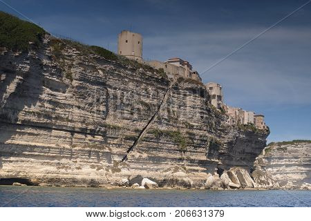 View of the south coast of Bonifacio with ancient tower Torrione and lower end of the famous historical monument stairs Escalier du Roi d'Aragon Bonifacio Bunifaziu , Corsica, France