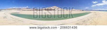Beach and lagoon at Playas De Sotavento near Risco El Paso. The lagoon is at Playa Barca.
