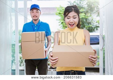 Asian woman and asian man carry boxes. Start up small business entrepreneur SME or freelance asian woman and man working with box online marketing packaging box and delivery SME concept