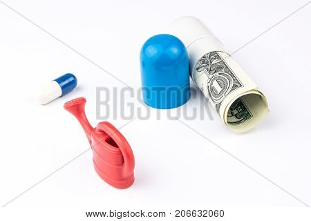 One Little Blue And White Pill, One Miniature Of Watering Can And One Big Capsule Looking Like A Pil