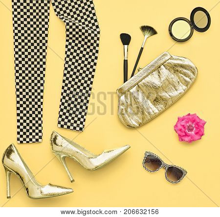 Fashion Design Outfit. Essentials fashion Cosmetic Makeup. Woman Clothes Accessories Set. Stylish Leggings, Glamor fashion Heels, Trendy Handbag Clutch, Sunglasses. Top view. Creative. Minimal