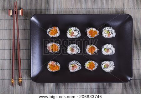 Sushi Roll With Salmon, Cucumber, Avocado, Red Caviar. Sushi Menu. Japanese Food. Close Up, Top View