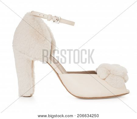 Beautiful female luxurious fur shoe, high-heeled, with décor, on white background, side view