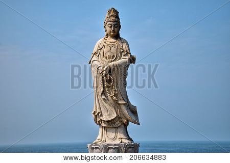 The statue of  the Guanyin Boddhisatva in the Chicken Island near Maoming, Guangdong province, China.