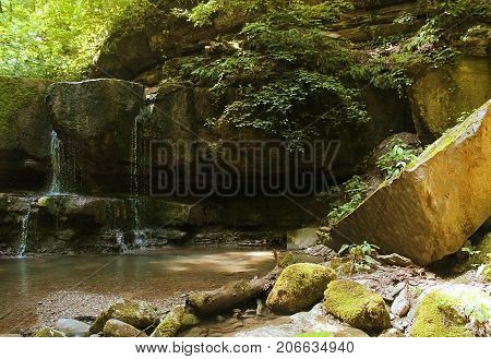 Water in the nature, stones which have acquired a moss, the nature in primitive in a look