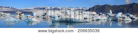 Panoramic view of floating icebergs in the glacial lake Jokulsarlon Iceland