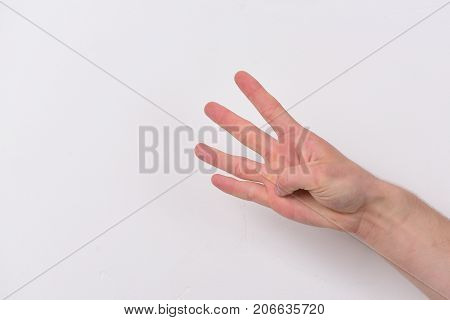 Count Down And Numbers Concept. Male Hand Shows Four Fingers