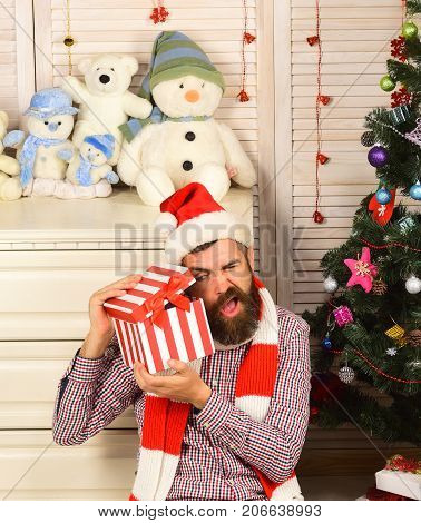 Man With Beard Peeps Into Present Box. Celebration And Surprise