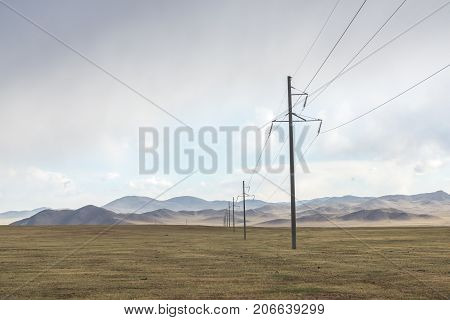 Electric power transmission pylons on inner mongolia grassland