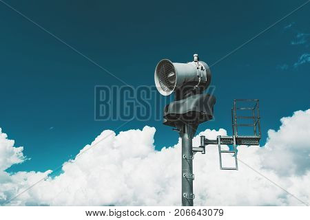 Close-up view of snow generator machine on tower with area for operator and stunning winter cloudscape in the background copy space zone for text your logo or advertising message bright day