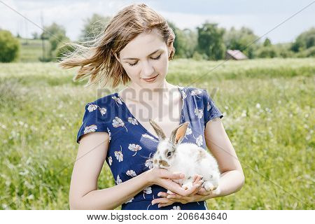 Young Girl With A Little Rabbit.