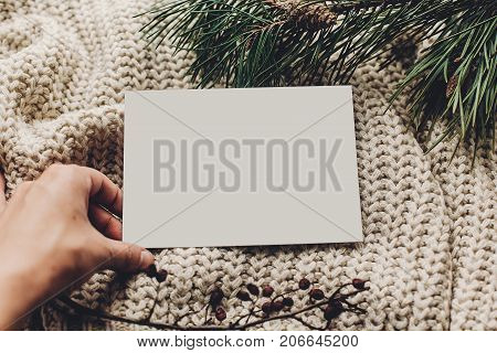 Christmas Empty Card. Hand Holding Blank Christmas Note Or Wish List On Stylish Simple Knitted Sweat