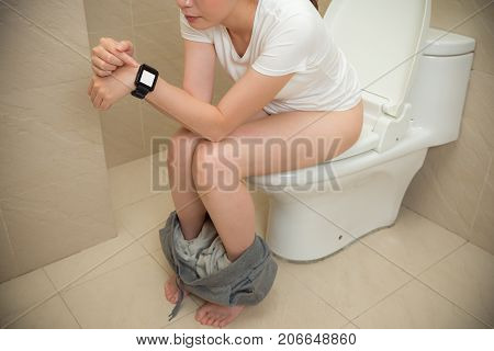 Photo Of Beautiful Sweet Sitting On Toilet