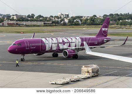 Boston USA 23.09.2017 - purple Airbus A321 airplane from Icelandic low-cost company WOW at at the International Airport
