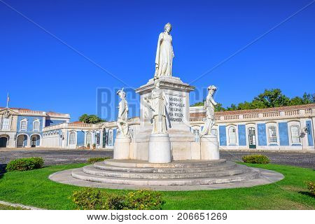 Statue of Queen Maria I of Portugal at entrance of National Palace of Queluz in Sintra, Lisbon district, Portugal. The Royal Palace of Queluz was the summer residence of the Portuguese royal family.