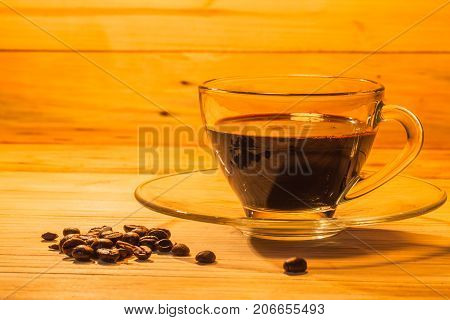 Transparent Coffee Cup And On Pinewood Table.