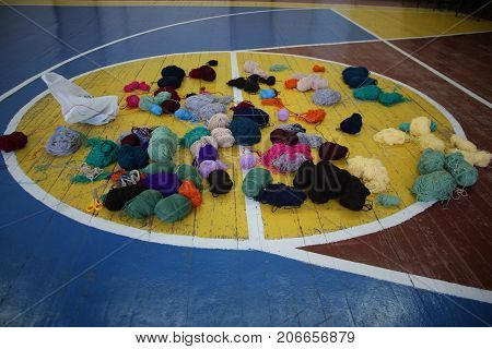 Multicolored balls of yarn on the basketball field