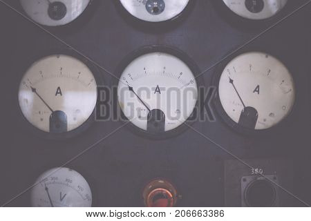 Old equipment for current measurement. Part of panel ammeter voltmeter dial