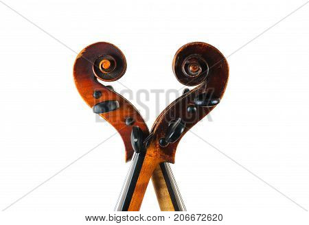 two  violin image .old brown stringed wooden instrument isolated on the white background