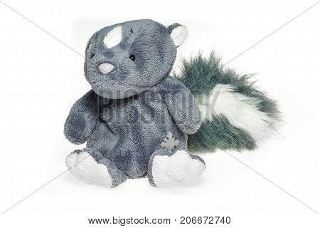 Sitting skunk plush toy isolated on white background