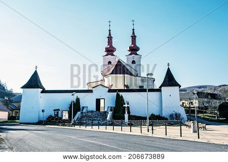 Roman catholic church in Divin village Slovak republic. Religious architecture. Cultural heritage. Beautiful place. Blue photo filter.