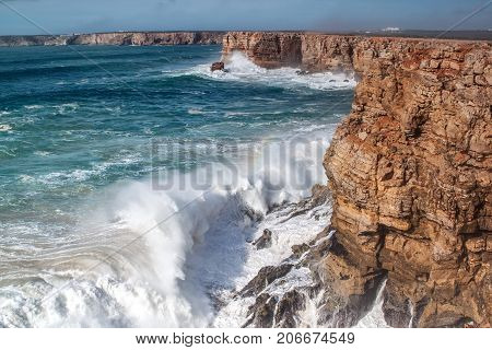 Giant waves hit the rocks, during a storm. Sagres Portugal