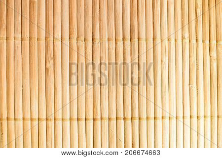 Bamboo background, light brown color, tied bamboo
