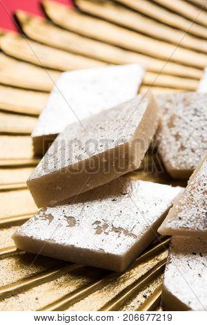 Stock photo of Kaju Katli, a popular indian sweet burfi made using milk, khoya, cachew and Sugar