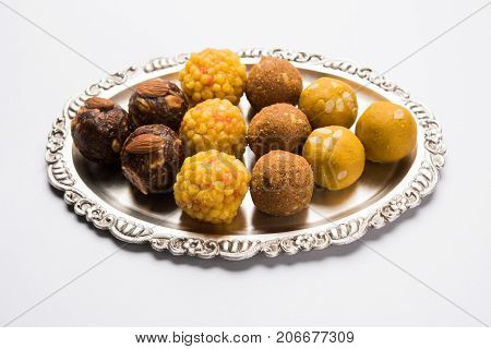 Stock photo of variety of sweet laddu or laddoo or ladu, a sweet dumpling made up of bundi, dry fruits or rava, selective focus