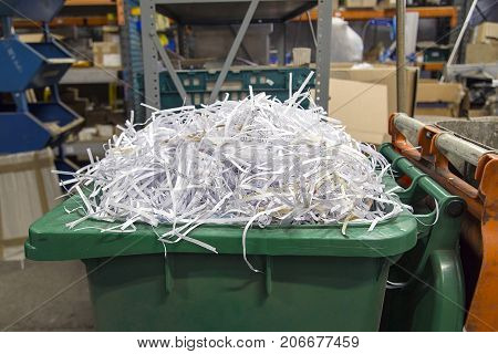 Shredded paper for recycling to be used in packaging in an industrial warehouse location
