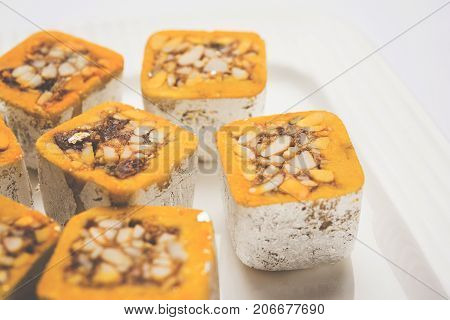 stock photo of sweet Mawa burfi for diwal wrapped with silver foili, selective focus