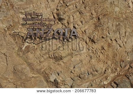 Anzota Caves, Arica, Chile - August 25, 2017: Sign at the entrance to Anzota Caves. The area was used as a settlement by the Chinchorro people and later mined for guano deposited on the cliffs.